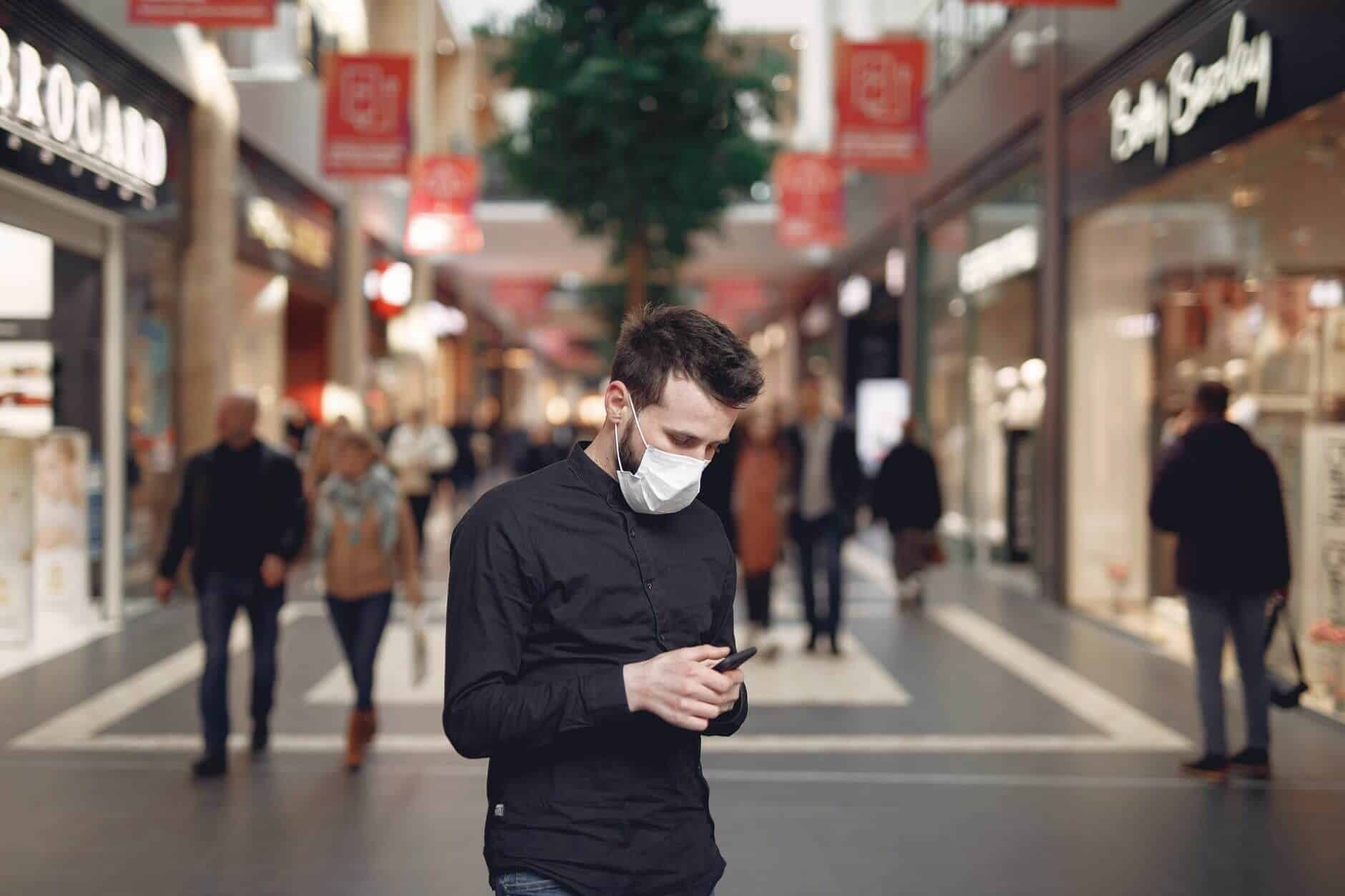 Man With Mask on in Mall