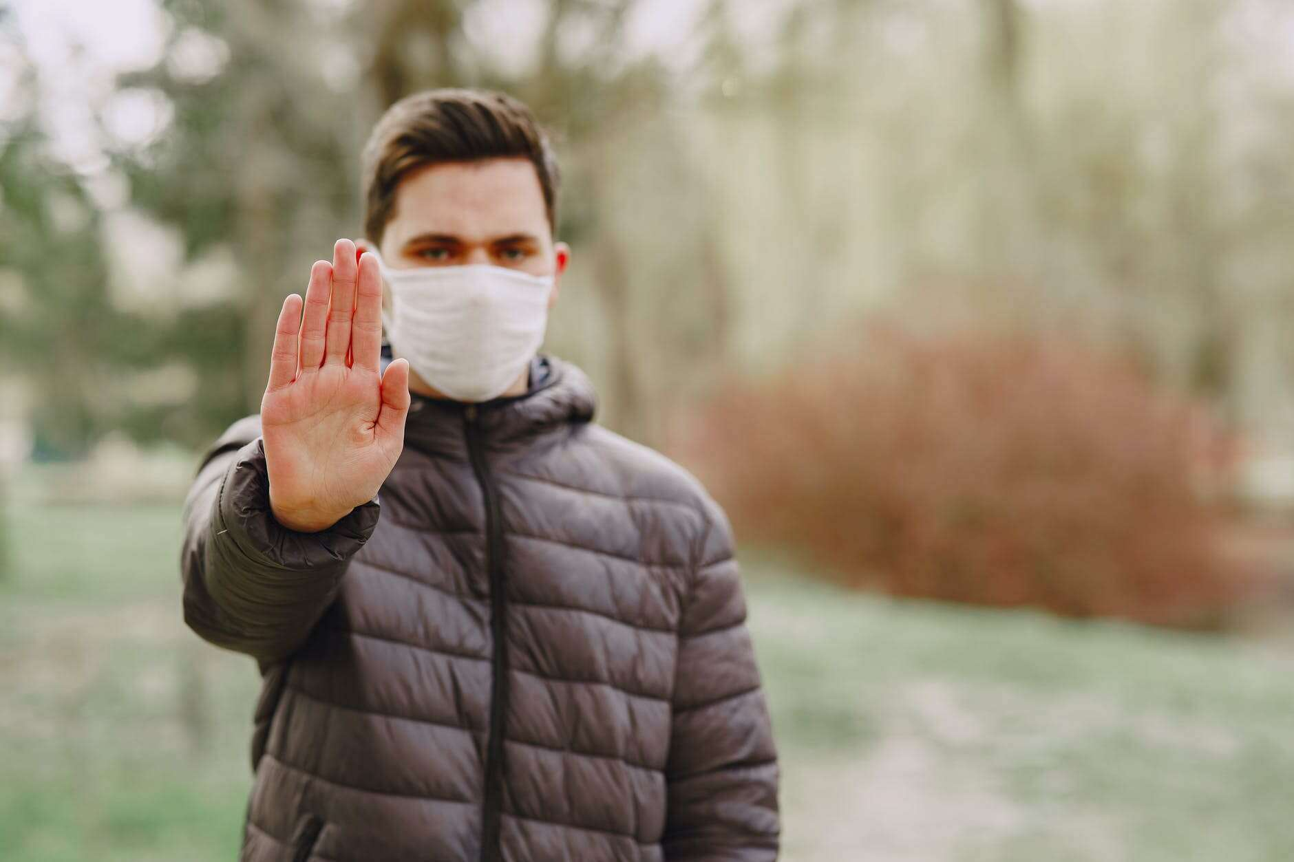 Man With Mask Holding Out Hand